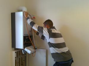 a Seal Beach plumbing tech checks the connection for a tankless water heater